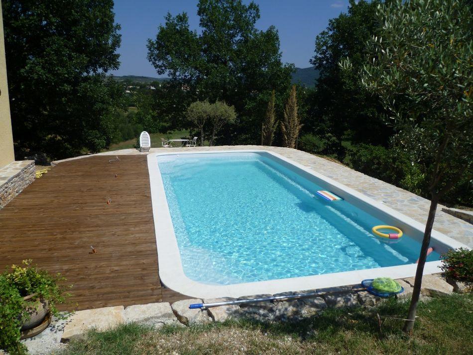 La piscine familiale piscine coque pour famille for Combler une piscine